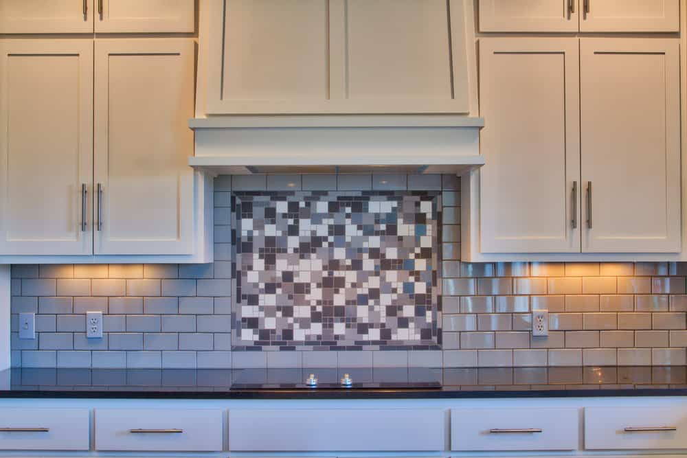 A Mosaic in the Middle of Subway Tiles modern kitchen ideas