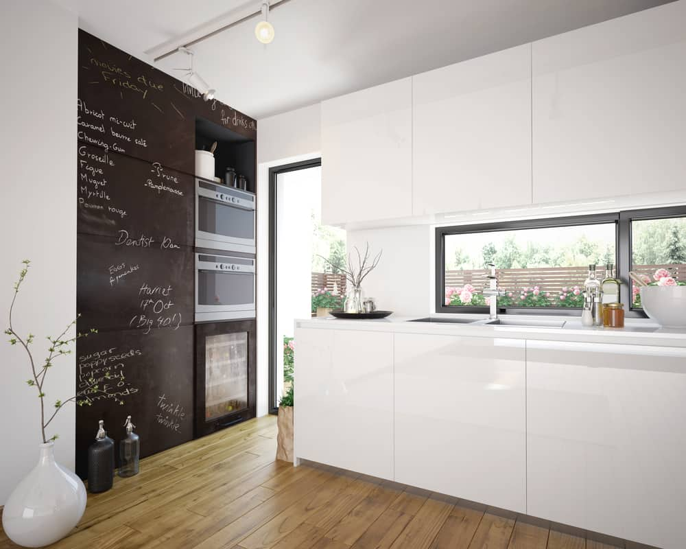Add Character by Adding in a Chalkboard Wall white kitchen ideas