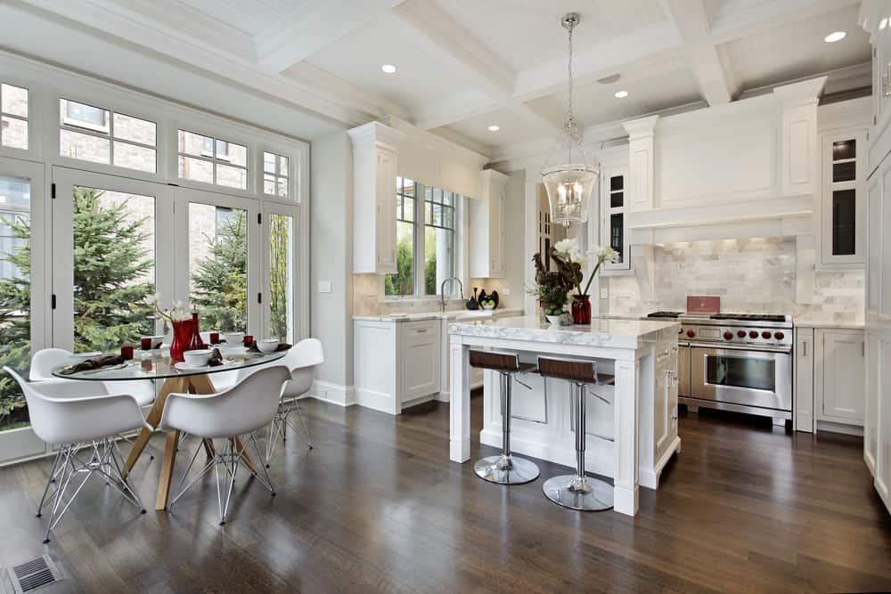 Dark Floors and White Cabinetry white kitchen ideas