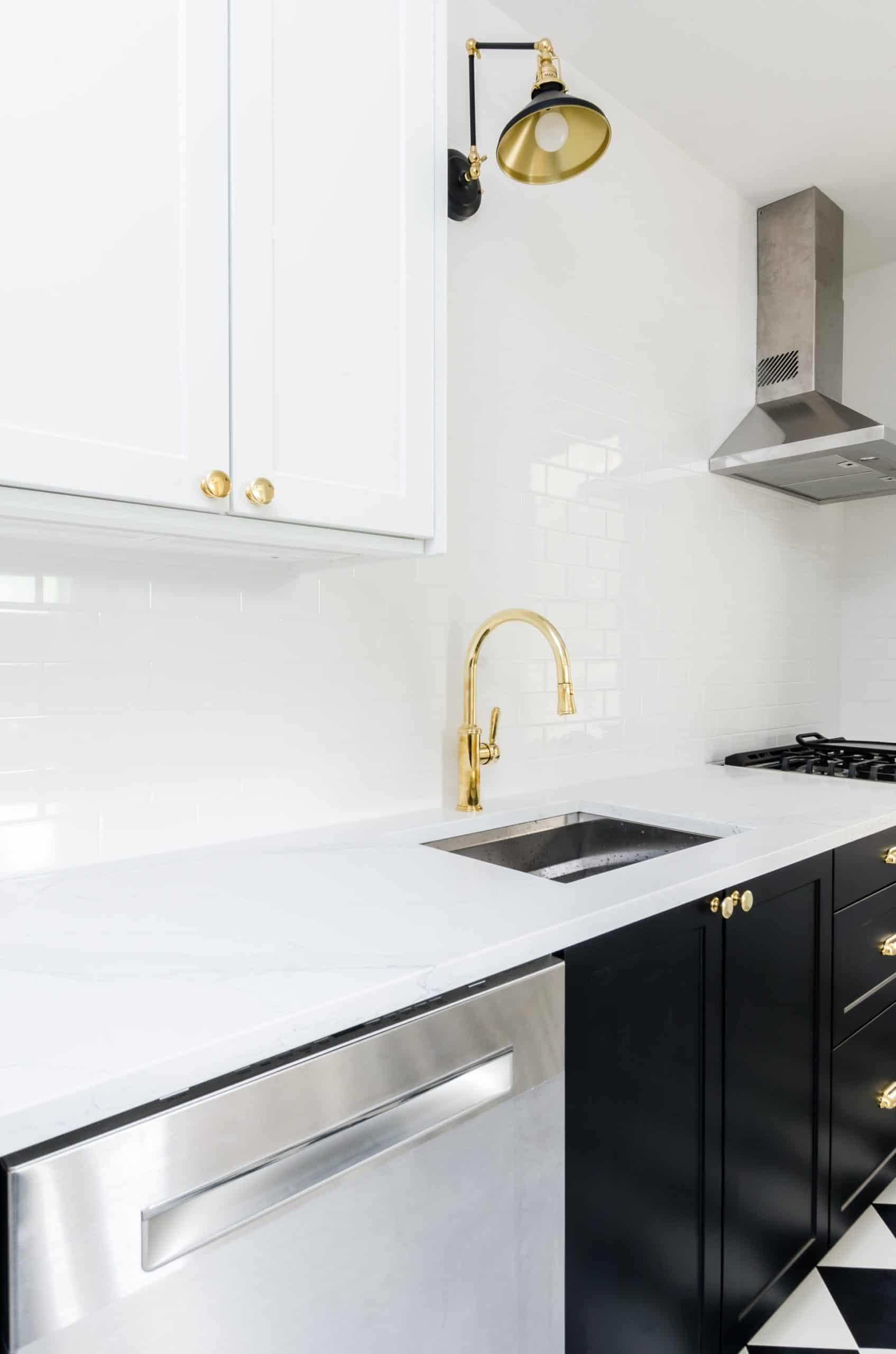 Gold Kitchen Faucet Paired with a Minimalist Undermount Sink kitchen sink ideas