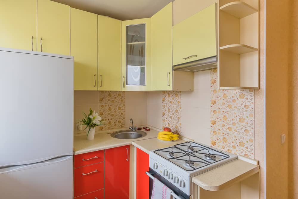 A Feminine Touch with Patterned Kitchen Walls yellow kitchen ideas