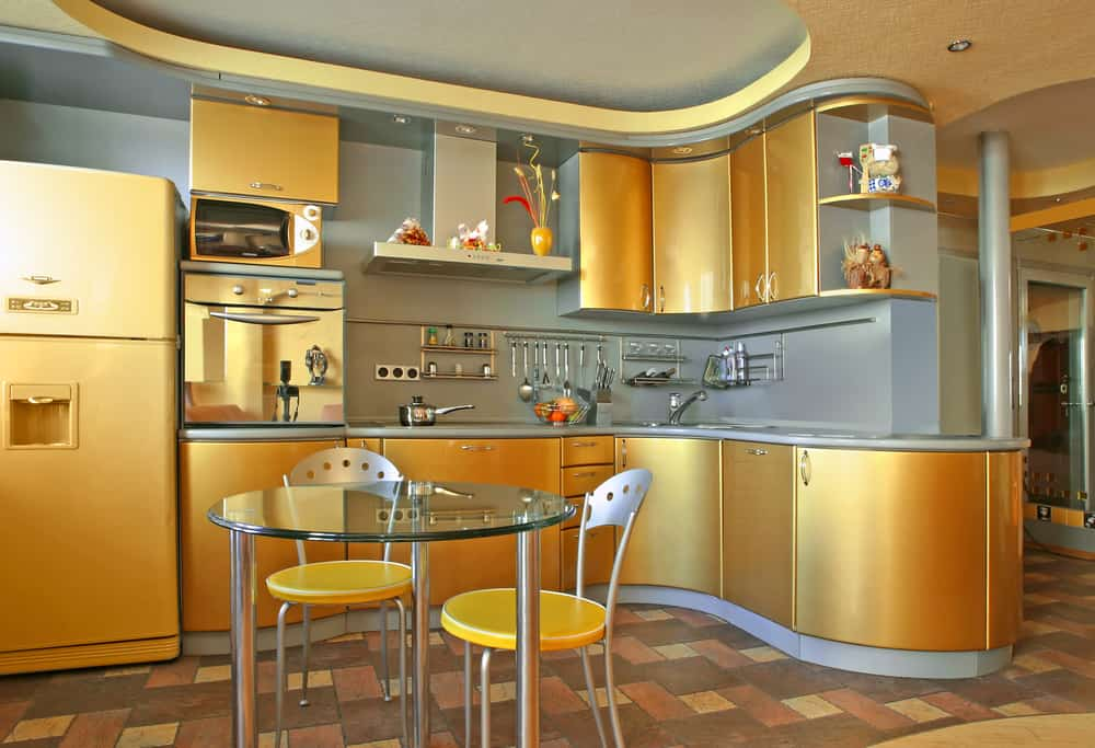 A Yellow Kitchen with a Spacey Vibe yellow kitchen ideas