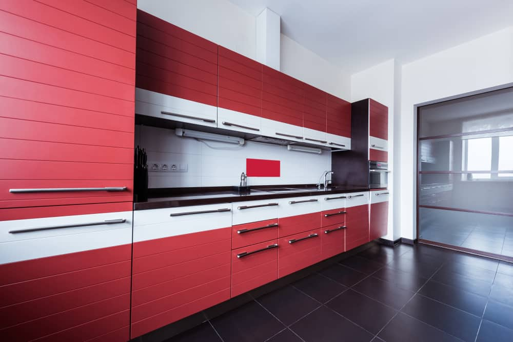 Paneled Red Cabinets red kitchen ideas